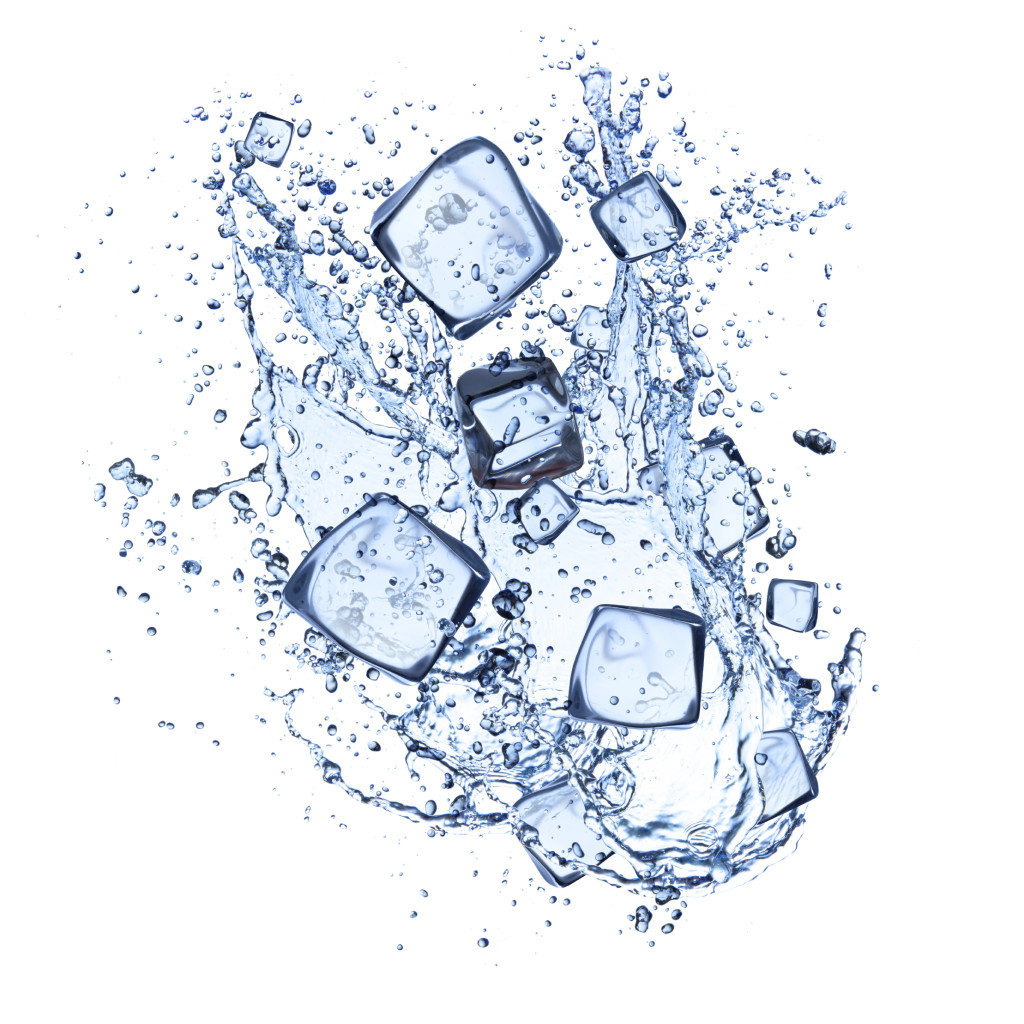 Ice cubes and water splashes on white background